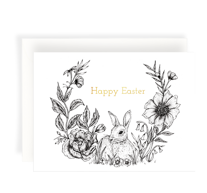 Beautiful ink illustrated card with a rabbit surrounded by flowers on a white background. Gold foil text says 'Happy Easter'