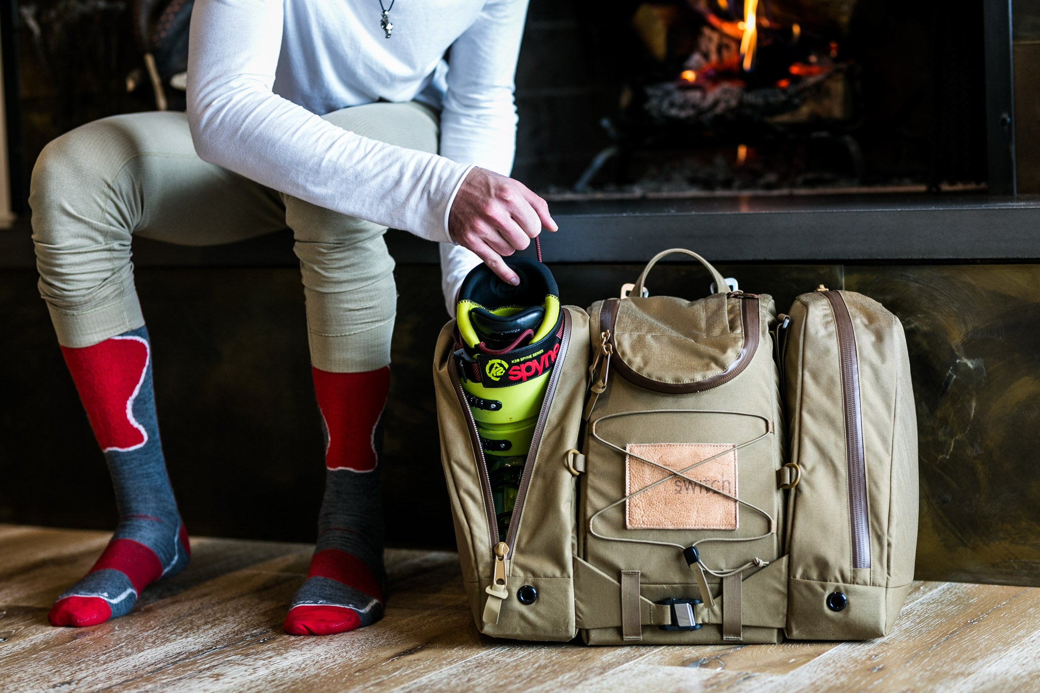 skier placing skiboot in tan Switch bootbag