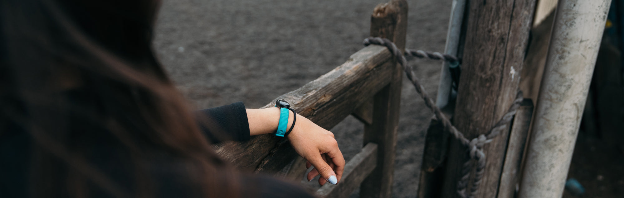Woman wearing blue Protect on her wrist