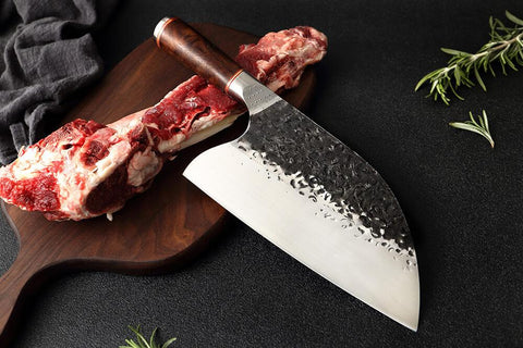 What is the best knife to use to cut raw meat?