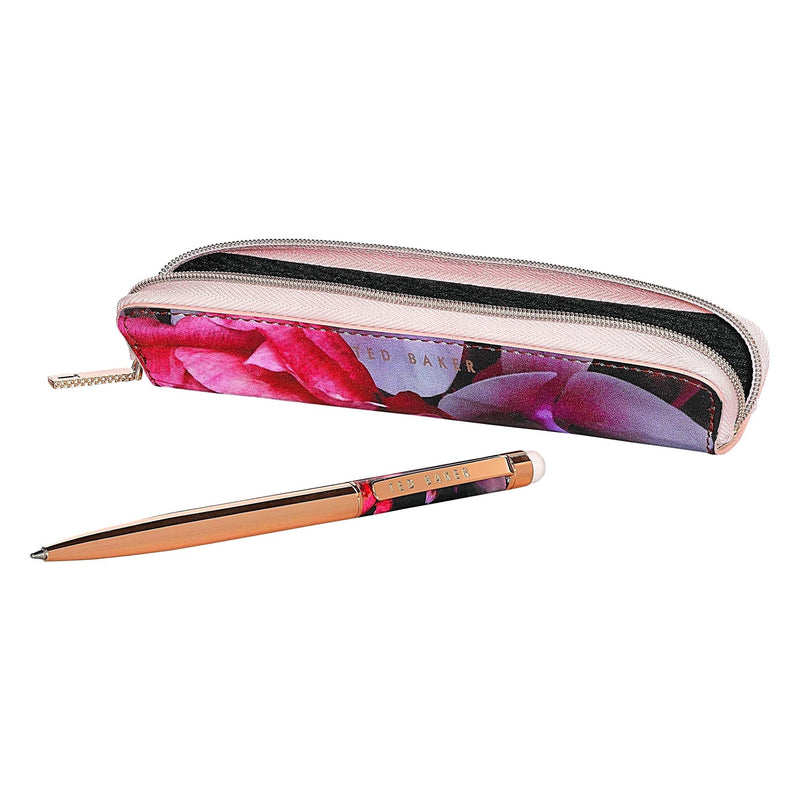 stylish rose gold Touchscreen Pen from Ted Baker. The slim, twist-style ballpoint pen writes in black ink and doubles up as a touchscreen stylus, complete with a Splendour print zipped case and branded pen clip. This statement stationery piece is ideal for taking with you on-the-go to take notes, write lists and jot down ideas. Box size: 175 x 65 x 35mm