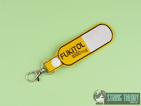 Fukitol 1000mg pill snap tab key fob ITH 4x4 machine embroidery design