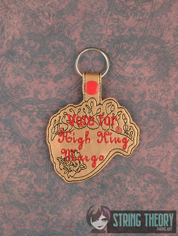 The Sorcerers Vote for High King Margo snap tab key fob 4x4 machine embroidery design