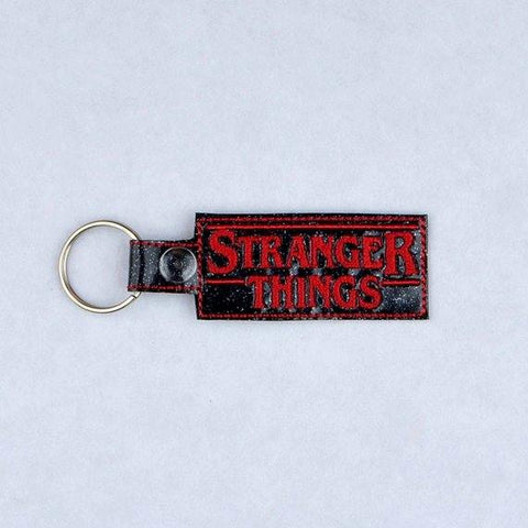 Unusual Stuff logo key fob snap tab ITH 4x4 machine embroidery design