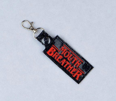 """Unusual Stuff"" Mouth Breather snap tab key fob ITH 4x4 machine embroidery design"