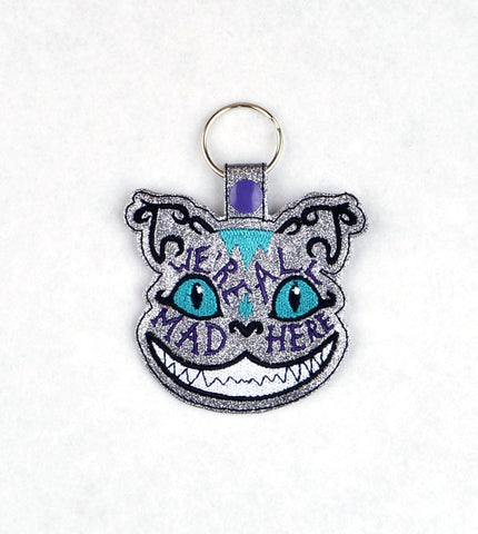Alice in Wonderland We're all mad here cheshire cat snap tab key fob ITH machine embroidery design 4x4
