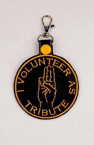 Hunger Games I Volunteer as Tribute snap tab key fob ITH 4x4 machine embroidery design