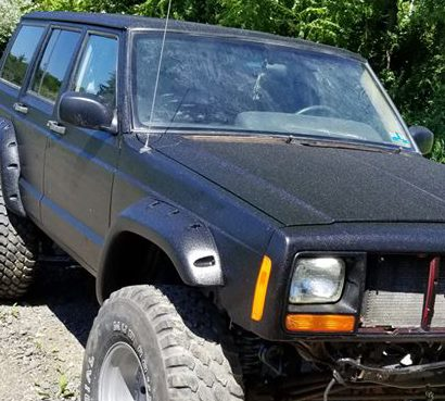 Black Bedlined Jeep Cherokee
