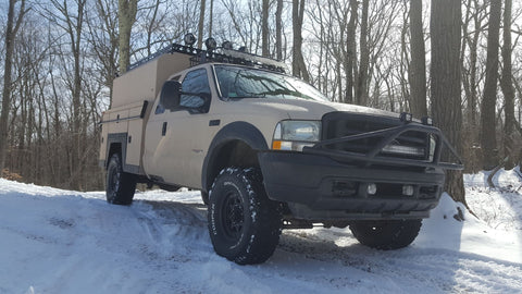 F250 Off-grid camper snow Durabak Coated