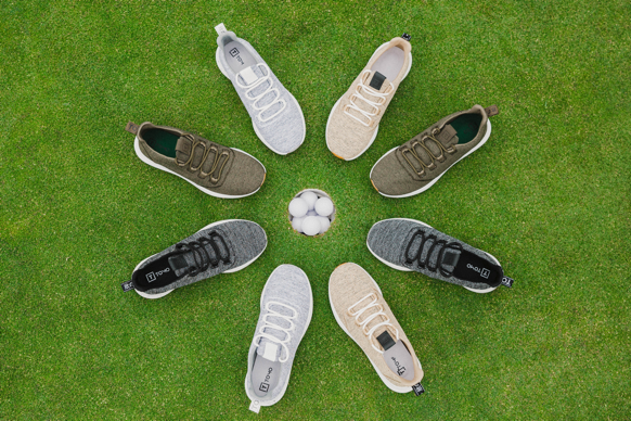 Tomo golf shoes in circle around hole