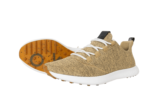 Pair of Tomo golf shoes in sand