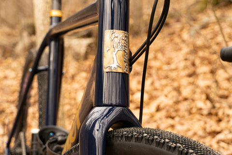 Rhys May silver and brass custom headtube badge