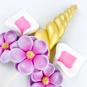 Unicorn Cake Topper with Gold Horn and  Lashes, Pink Ears and Lilac Flowers Closeup
