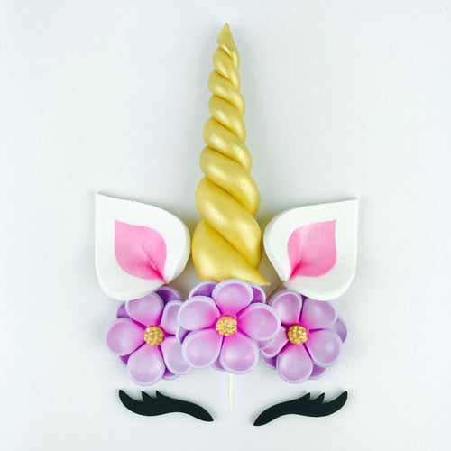 Unicorn Cake Topper with Gold Horn, Pink Ears, Black Lashes and Lilac Flowers