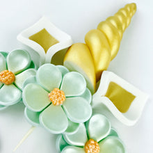 Unicorn Cake Topper with Gold Horn, Ears, Lashes and Teal Flowers Closeup