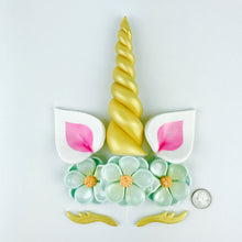 Unicorn Cake Topper with Gold Horn, Pink Ears, Gold Lashes and Aqua Blue Flowers size comparison