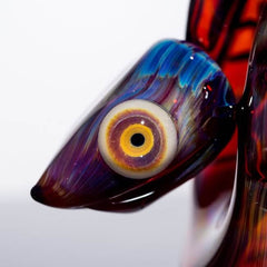 product shot of snake head and eye glass snake by Niko Cray in Amber Purple