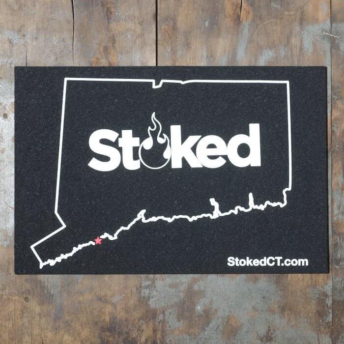 Stoked 12x18 inch mood mat, state of connecuticut outline with red location star and stoked logo centered. Stoked URL bottom right.
