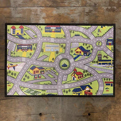 Mood mat on a wood background with an image of city roads and buildings on the front