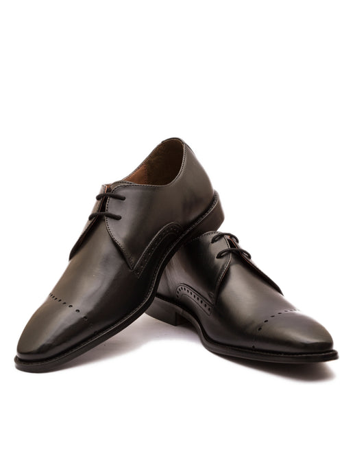 The Meticulous Linear Brogued Black Derby