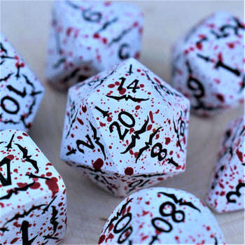 close up shot of vlad metal dice set d20