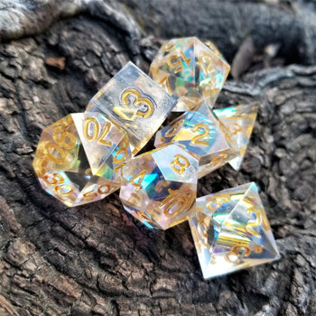 CELESTIAL GOLD SHARP EDGE RESIN DICE SET