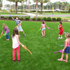Group of kids playing RingStix at the park