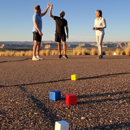 Family enjoying Bocce outdoors for camping games