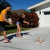 Siblings playing Ring Toss Deluxe by Funsparks in the front yard