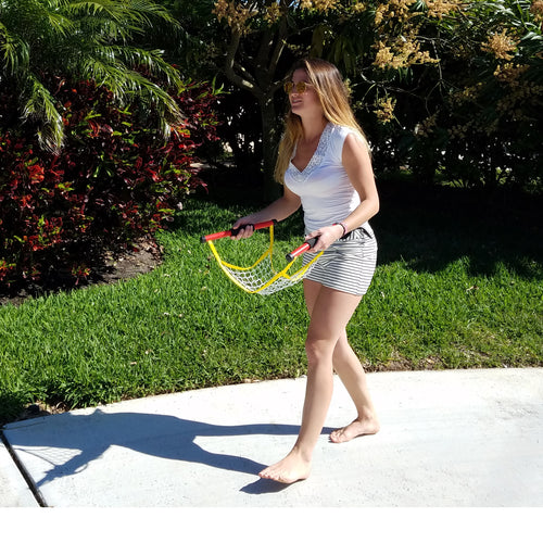 Teen girl playing Switch Ball in the front yard