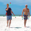 Friends playing Lawn Darts at the Beach
