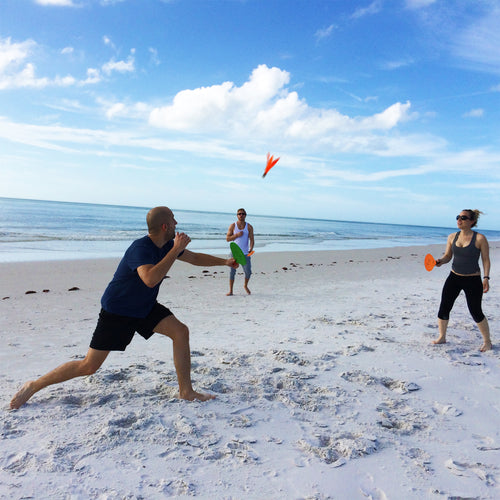 Friends playing Jazzminton at the beach