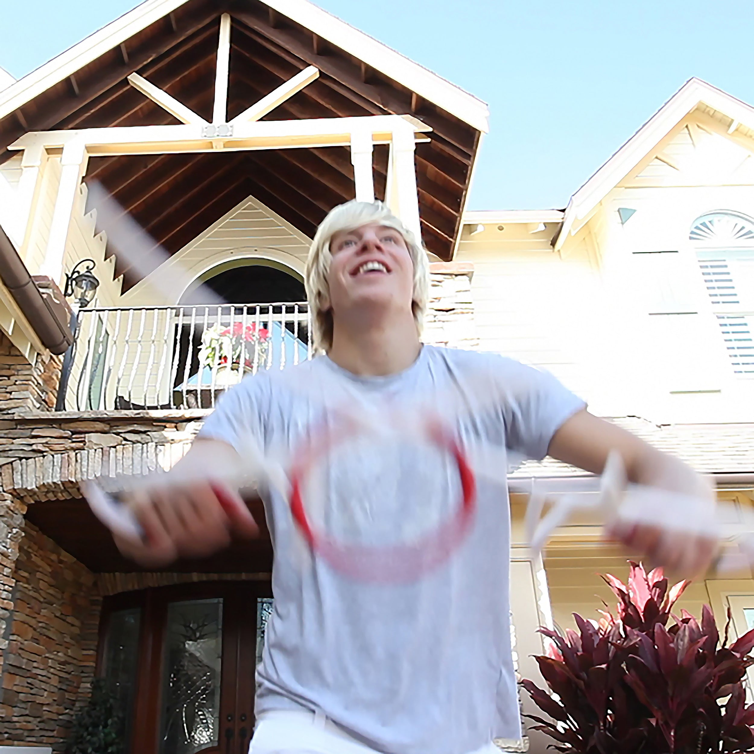 teen having fun shooting RingStix in front yard