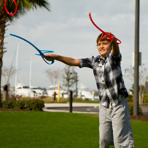 Kid tossing RingStix Ring having fun in the park