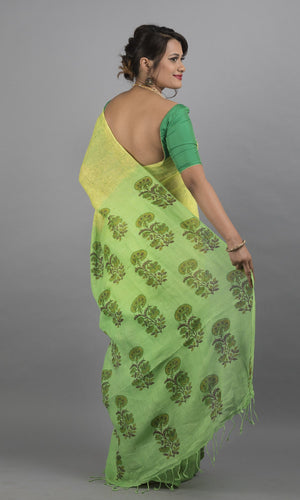 Handwoven linen in green with handblock printed floral design