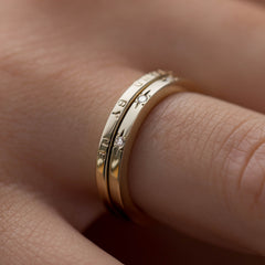 Handstamped personalised ring and a diamond ring