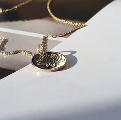 solid gold pendant with a Lotus flower hand-stamped design