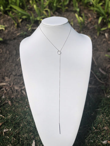 Sterling silver adjustable lariat necklace.   circle pendant with cubic zirconia stones.