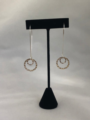 Handmade sterling silver Kidney wire earrings with hanging floating discs.