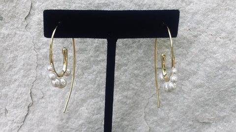 Thread through style vermeil over sterling silver earring.   There are five synthetic pearls.