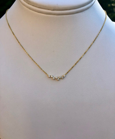 Vermeil over sterling silver necklace with a CZ pendant with eight small stars.