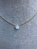 Necklace has a small opal star.  The necklace is vermeil over sterling silver.