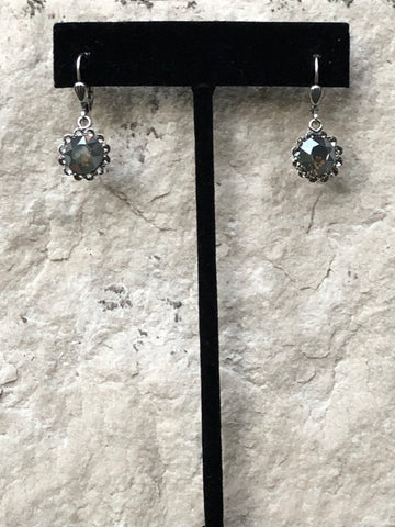 Handmade hanging flower shaped earrings - La Vie Parisienne by Catherine Popesco.  Earrings are antiqued sterling over a copper base with dark grey Swarovski crystals.   Earrings are Lever backs .