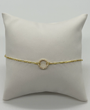 Open circle bracelet with cz's with a chain in vermeil over sterling silver.