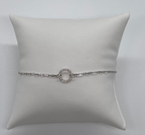 Open circle bracelet with cz's with a chain in sterling silver.