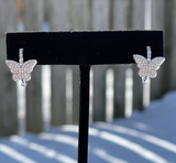 Sterling silver huggie earrings with a micro pave cubic zirconia butterfly.