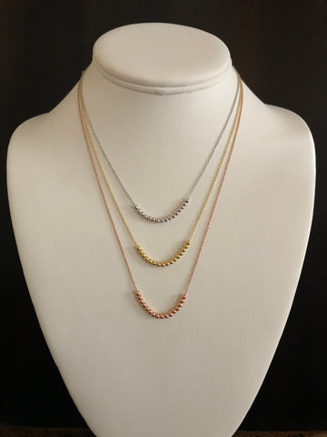 sterling silver, vermeil over sterling silver and rose gold over sterling silver beaded necklace.
