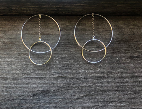 Sterling silver double hoop with chain earrings.