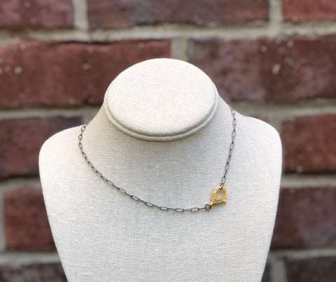 This necklace is handmade with oxidized sterling silver.   The necklace has a vermeil over sterling silver diamond lobster clasp.