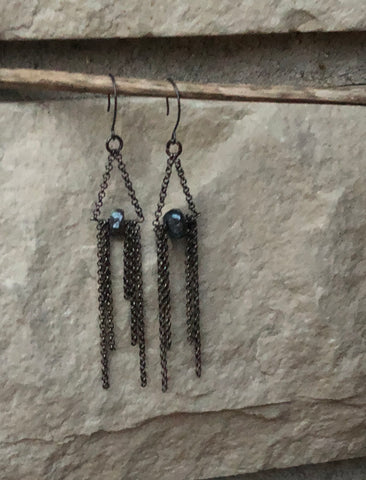 This handmade earring has hanging chains with a genuine labradorite stone.   The earrings are oxidized sterling silver.